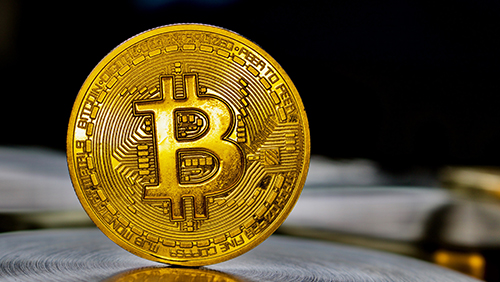 Bitcoin tops $2,100 as global demand for digital money rises